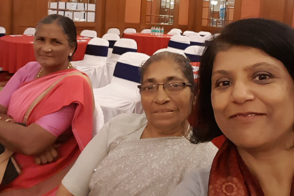 Meenakshi with Karnataka Domestic Workers Union leaders